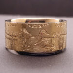 Precious metal yellow gold duck band with dog ring